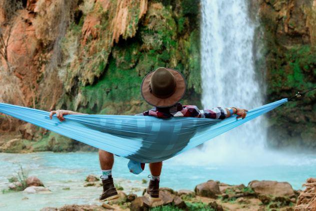 Man in hammock near water - Unsplash image