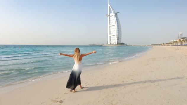 Woman walking on beach - Pexels image