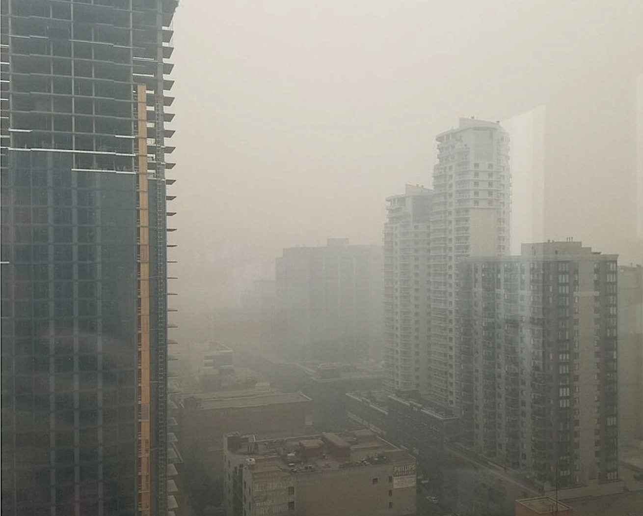 Smoke from massive wildfires shrouds Canadian cities in