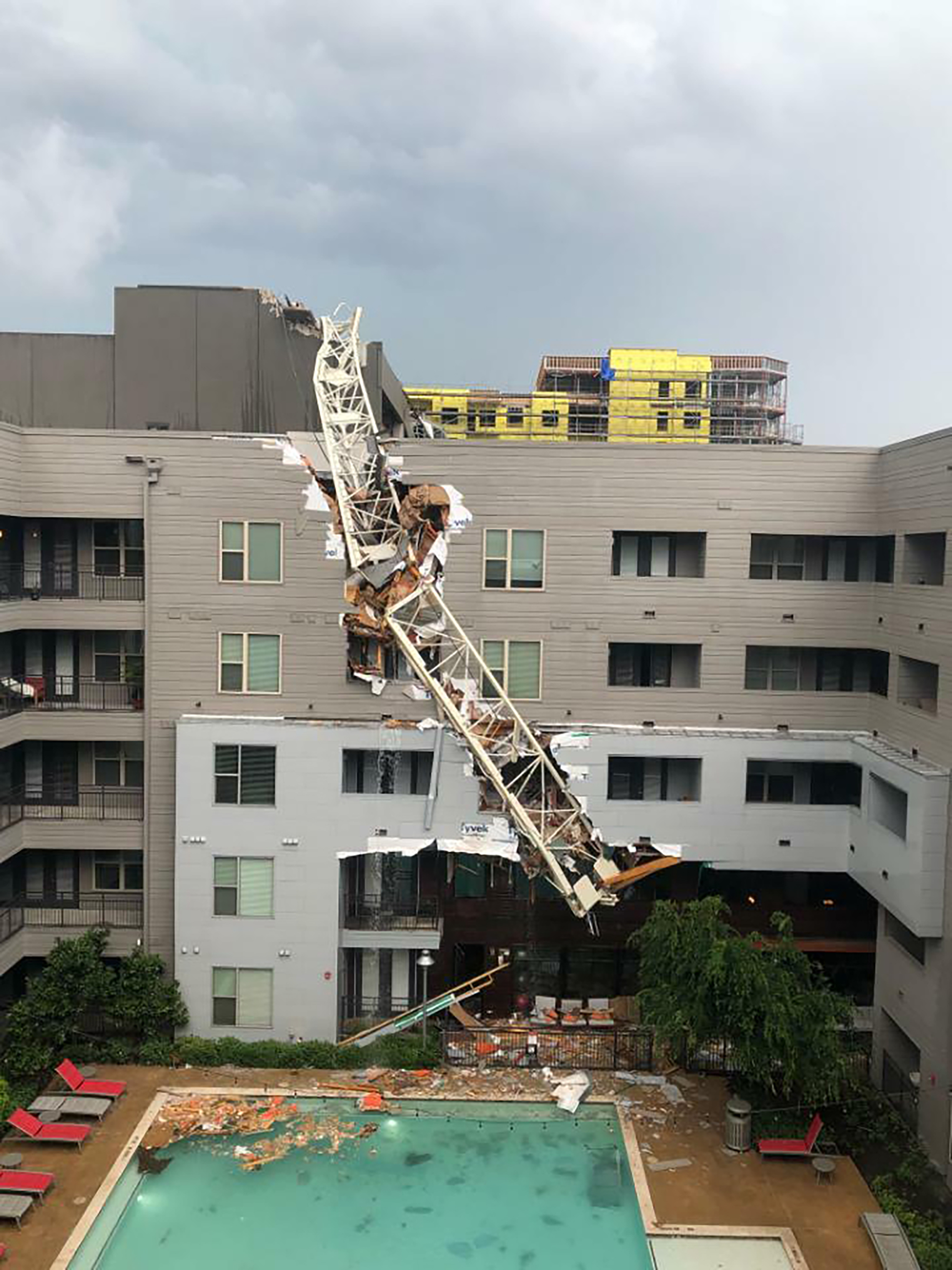 Crane collapse amid severe weather leaves at least 1 dead in