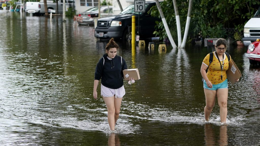 Eta's second Florida landfall floods cities, traps dozens in cars and homes